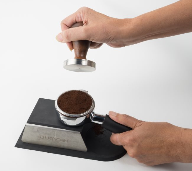 Image of a wooden handled tamp. Picture is from Fourth Estate's article on how to make a perfect espresso.